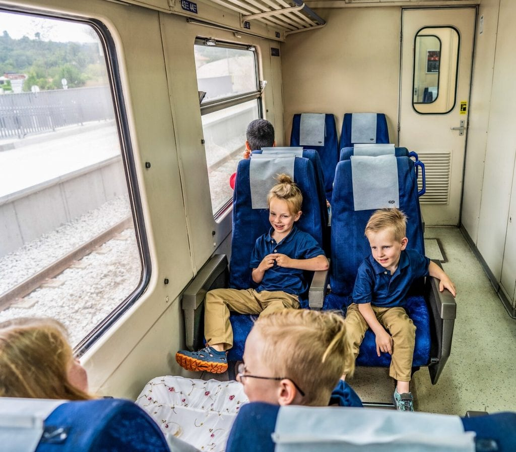 worldschooling- my boys and oldest daughter sitting on the train