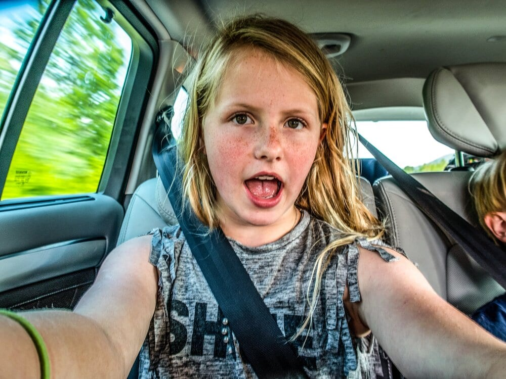 my oldest daughter took a selfie in the car