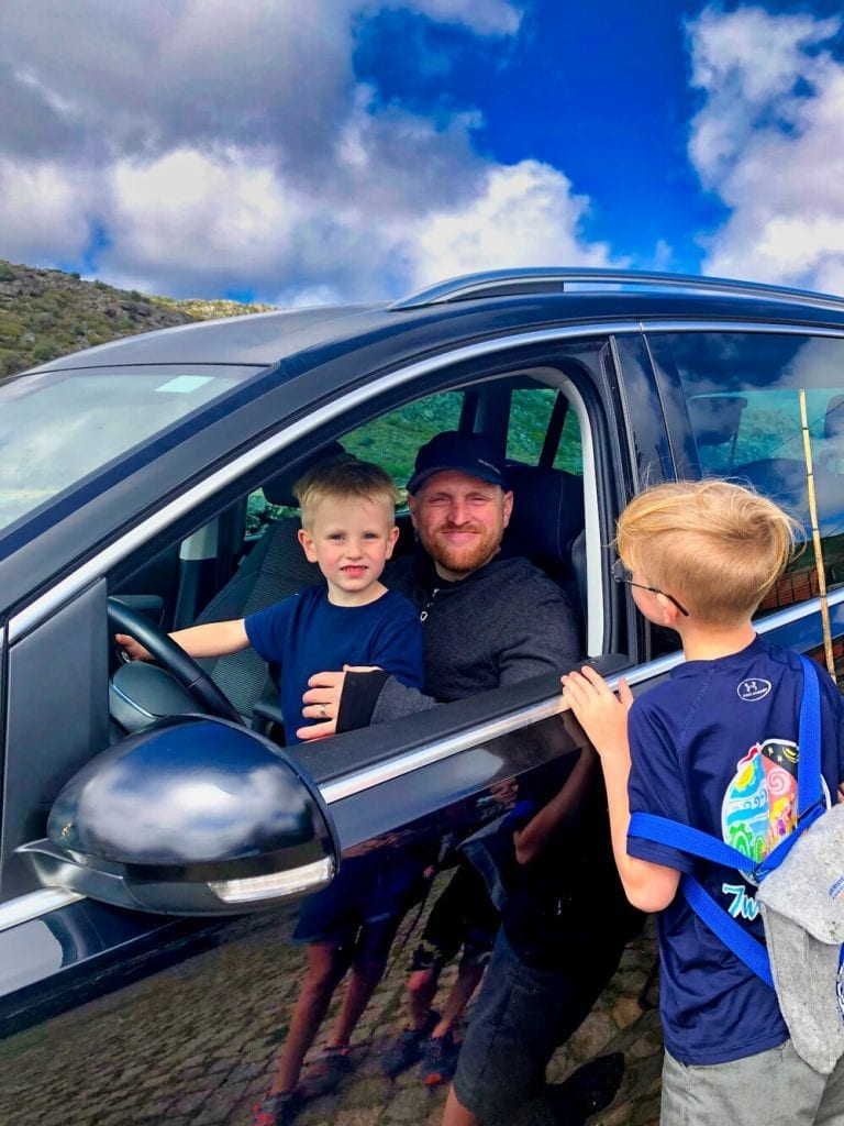 my husband and 2 of my sons sitting in the car