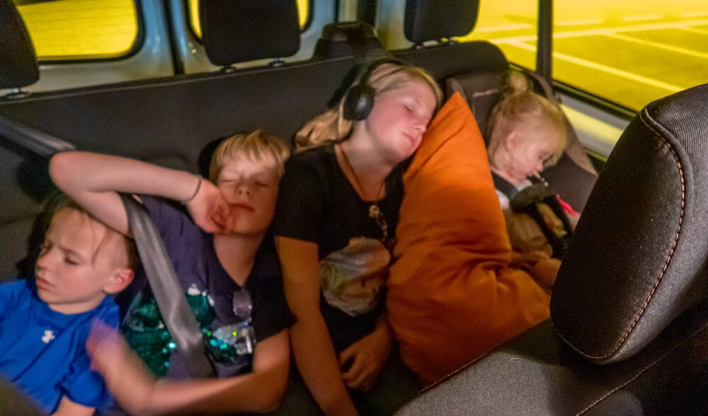 4 of my kids sleeping in the back of the van