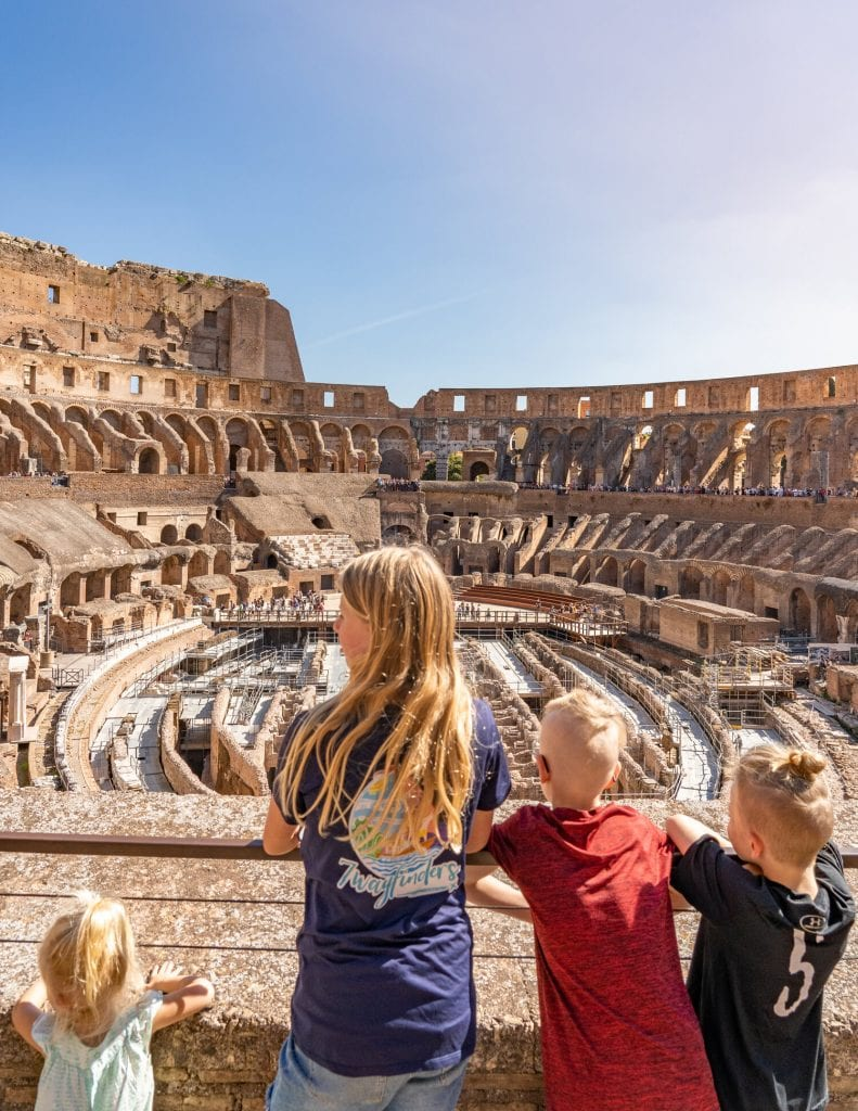 worldschooling- 4 of my kids looking at the Roman Colosseum for the first time