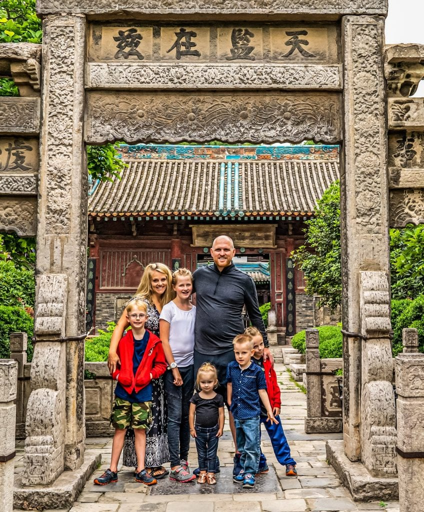 My family in front of a temple in Asia