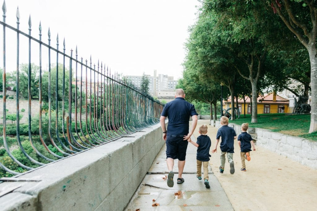 family travel- my husband and sons walking on the sidewalk