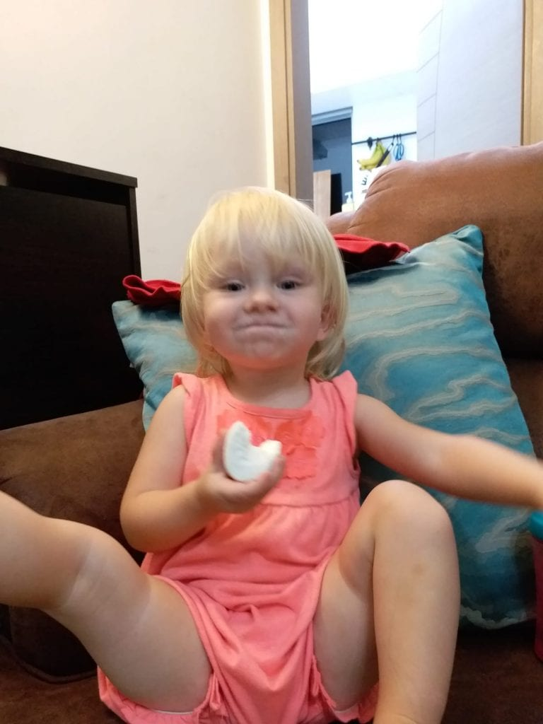 Travel mishaps- Our baby eating snacks on the couch