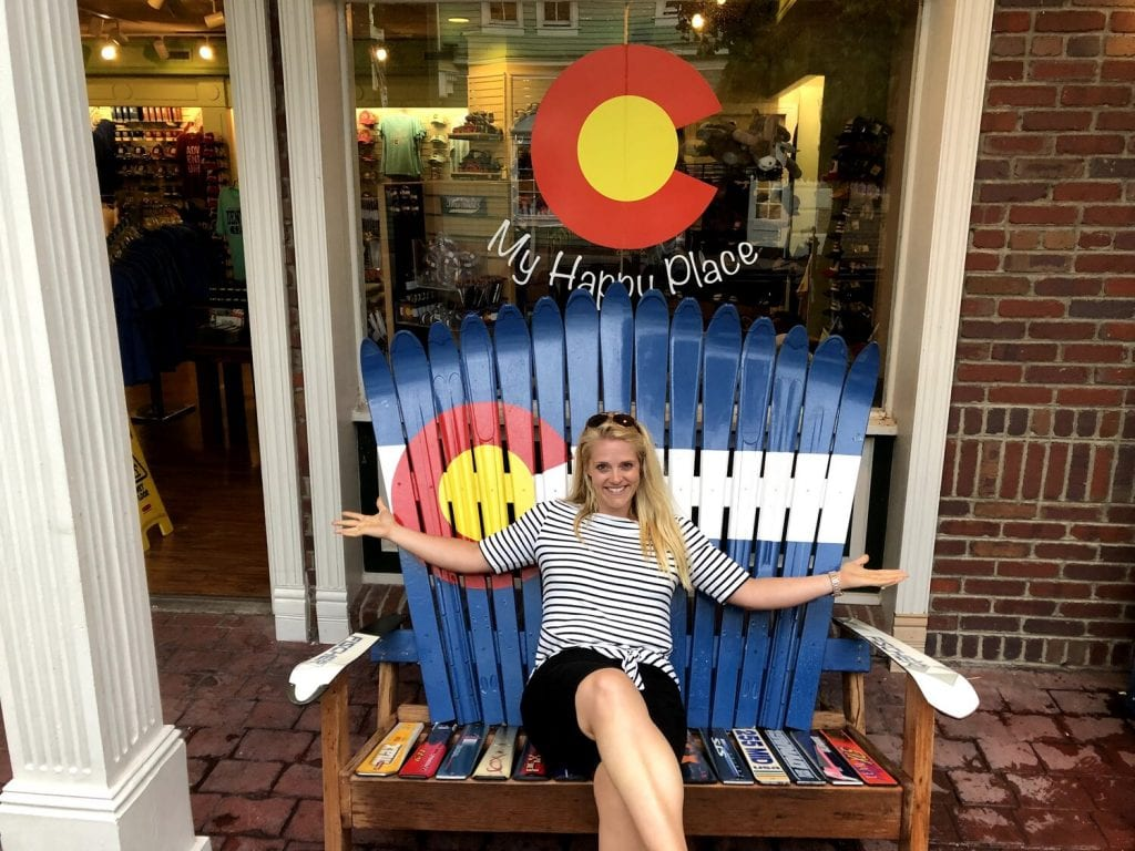 trip around the world- me sitting in a cute Colorado chair made from skis!