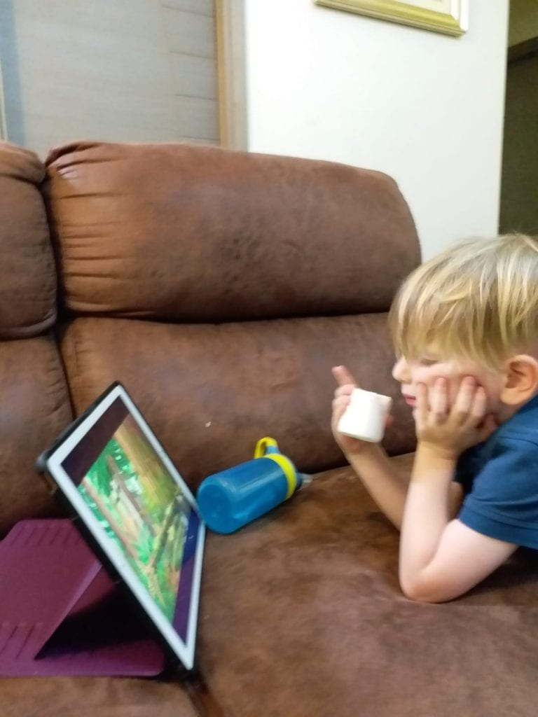Travel mishaps- our son watching iPad on the couch