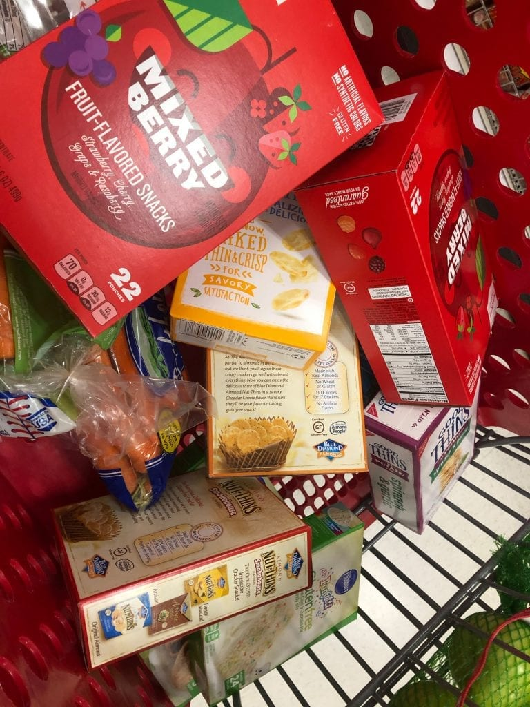 trip to the USA- a cart full of familiar snacks, fruit snacks, crackers, baby carrots