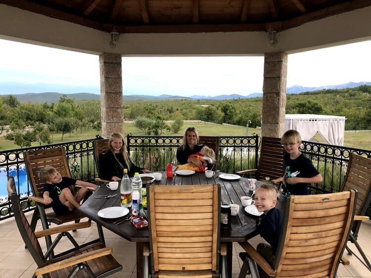 family travel- our family dinner outside with a pretty view