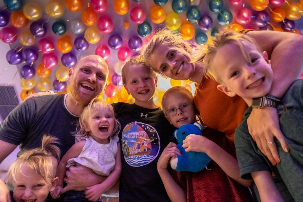 bangkok with kids- a family picture with a colorful balloon back drop