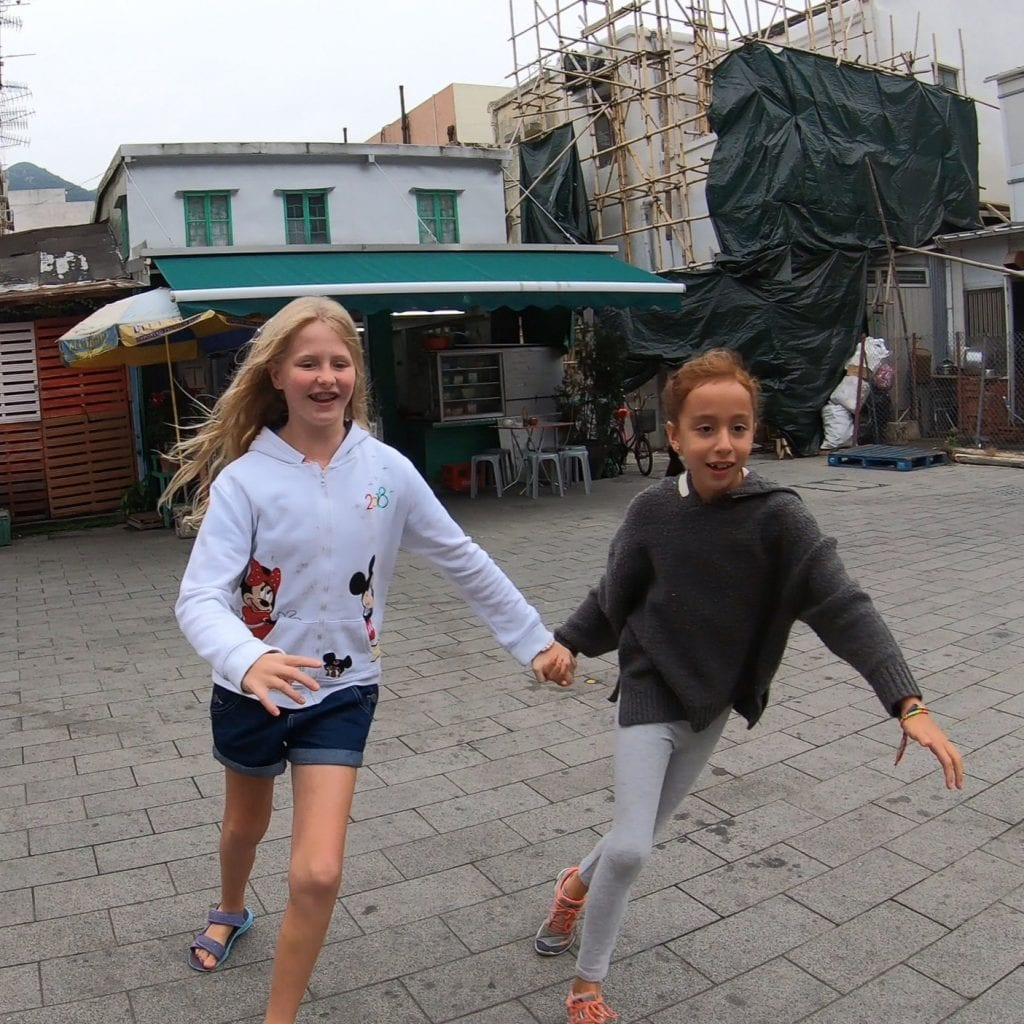 family travel- my daughter playing with a friend her age