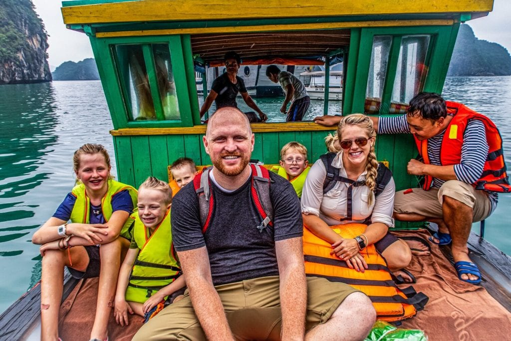 trip around the world- family picture on a green and yellow boat in Halong Bay