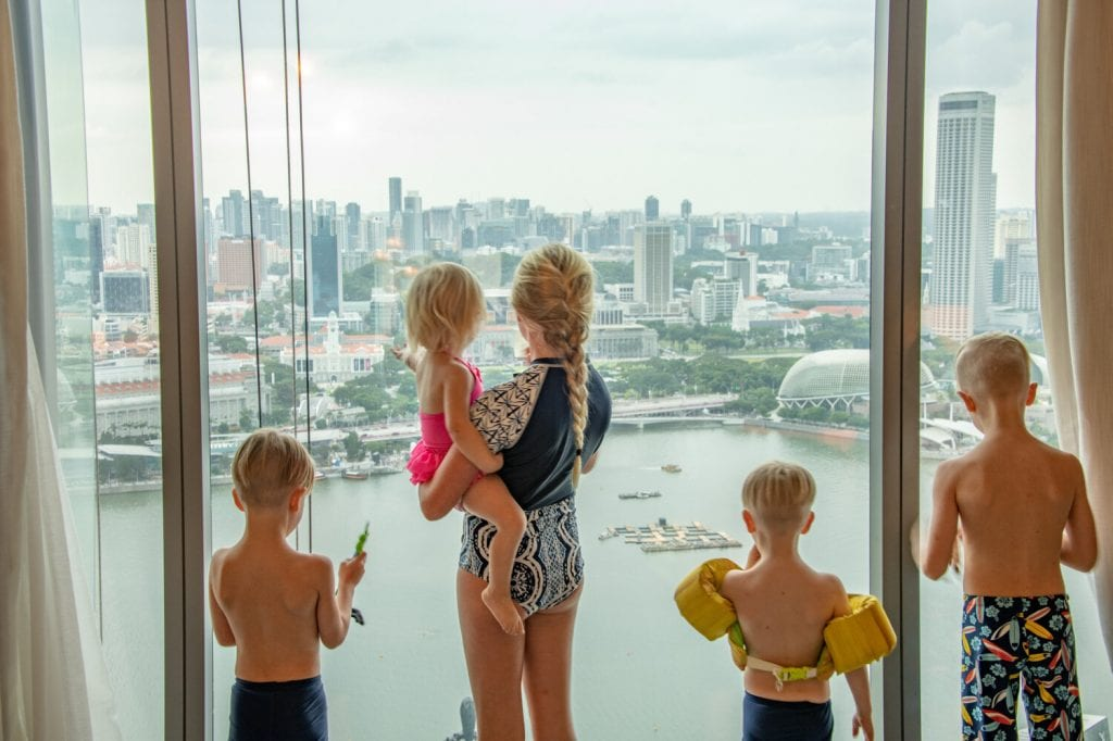 singapore travel guide- my kids enjoying the view of downtown from our hotel window
