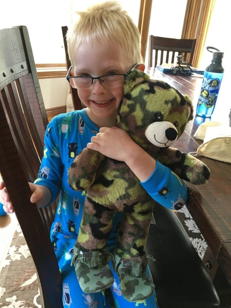 how to deal with homesickness- my oldest son and his camouflage teddy bear.