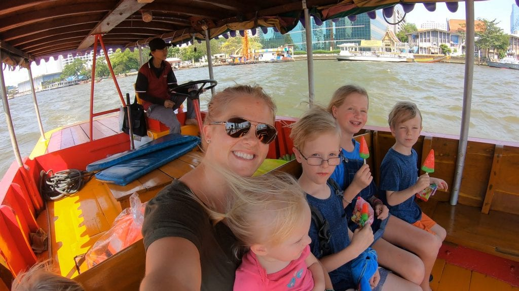 bangkok with kids- me and my kids on a boat in the river
