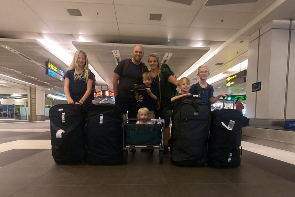 family travel- all 7 of us with our luggage at the airport