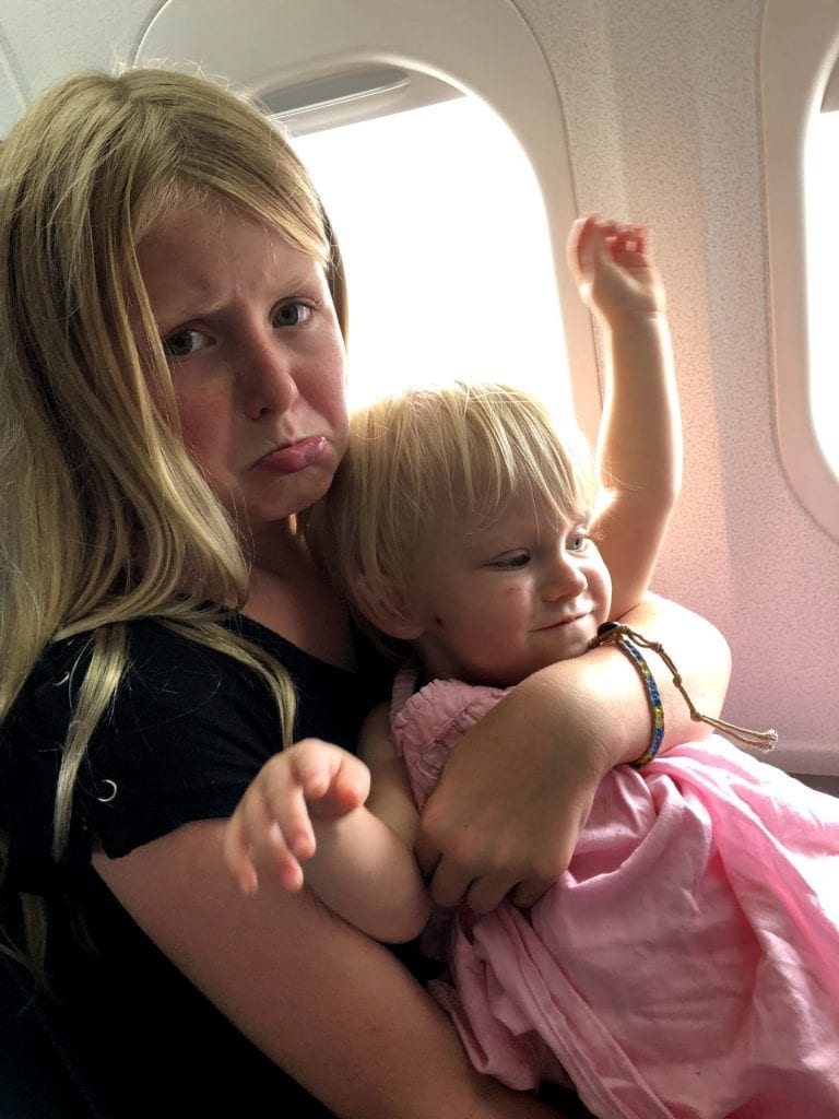 Tips for flying with kids- 2 of my kids on the airplane