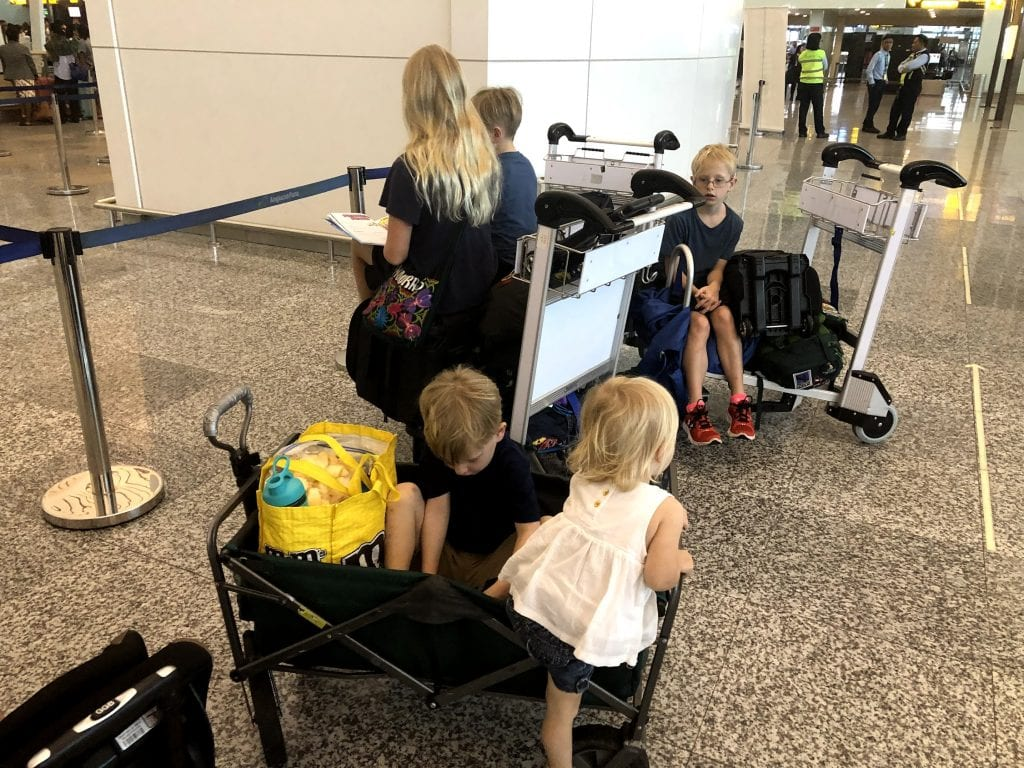 The kids piled into a wagon at the airport