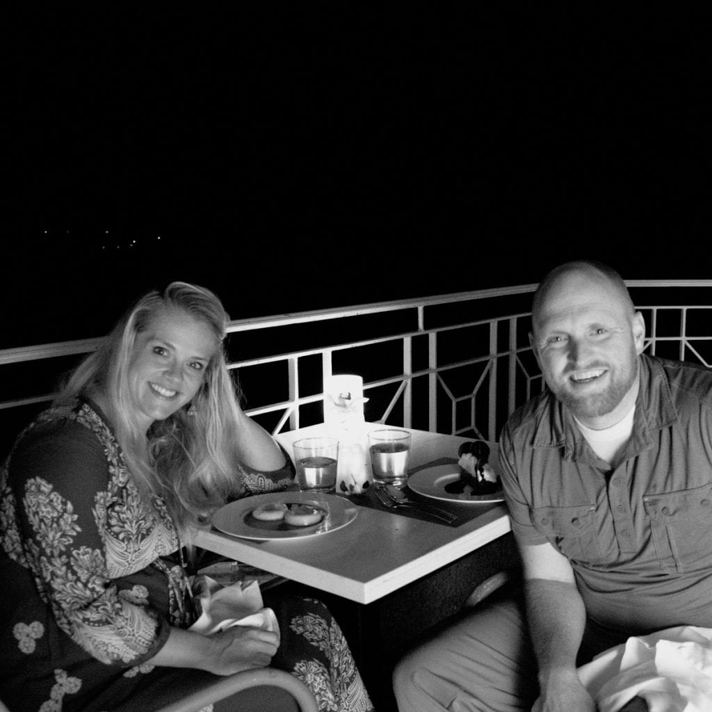 Black and white photo of Chris and Leslie at dinner in Kauai