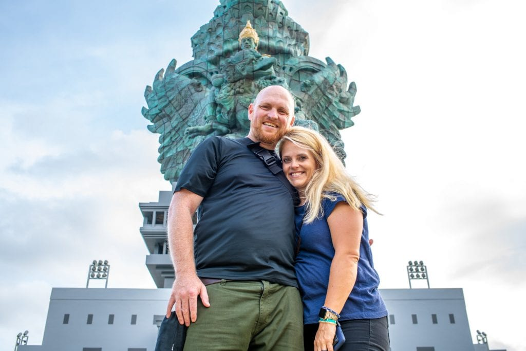 Chris and I in front of a statue in Bali