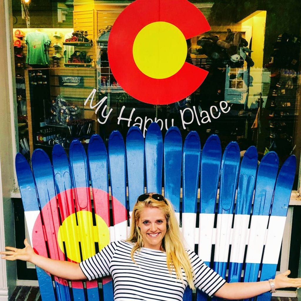 Me sitting on a chair made of snow skis, painted like the Colorado flag
