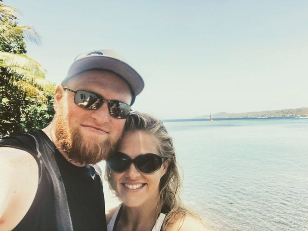Chris and Leslie taking a selfie infant of the light blue ocean
