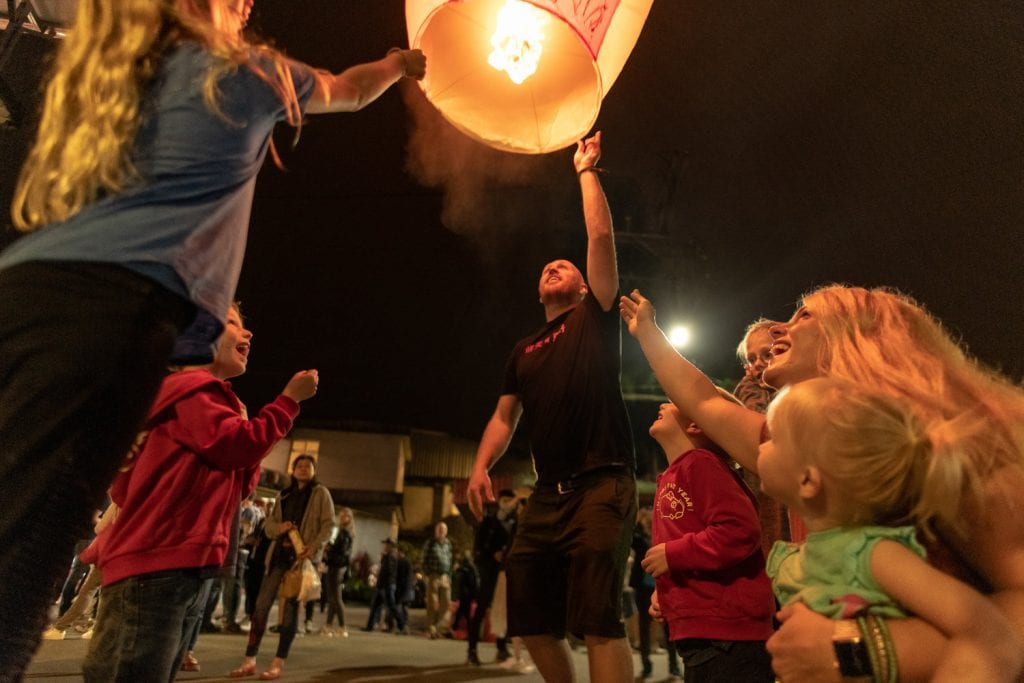 Chris helping the kids release a lantern into the sky