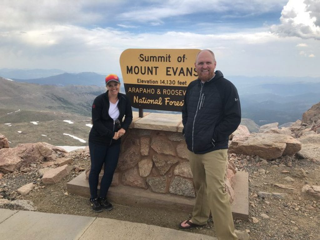 Us with the Summit of Mount Evans sign