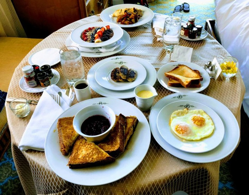 Our room service at the Broadmoor, breakfast in bed. Glass plates with eggs, French toast, oatmeal, etc.