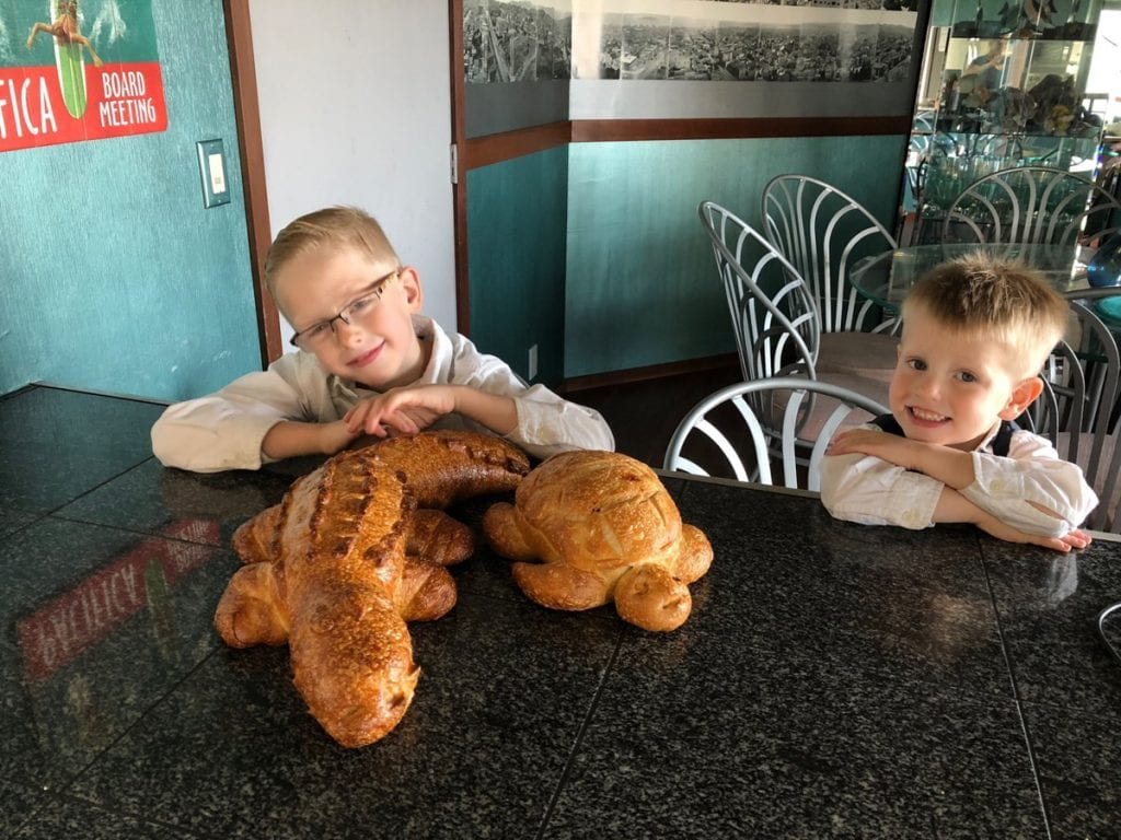 Harrison and Grant with the alligator and sea turtle shaped sourdough loaves.