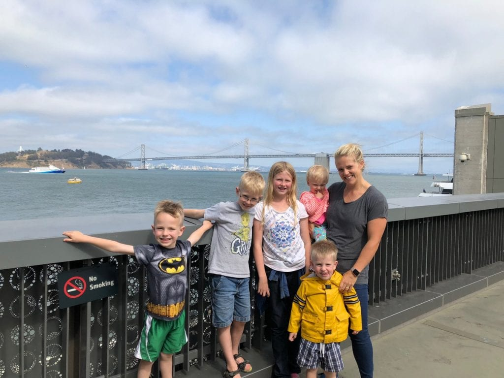 Leslie and the kids with an ocean and bridge view in the background