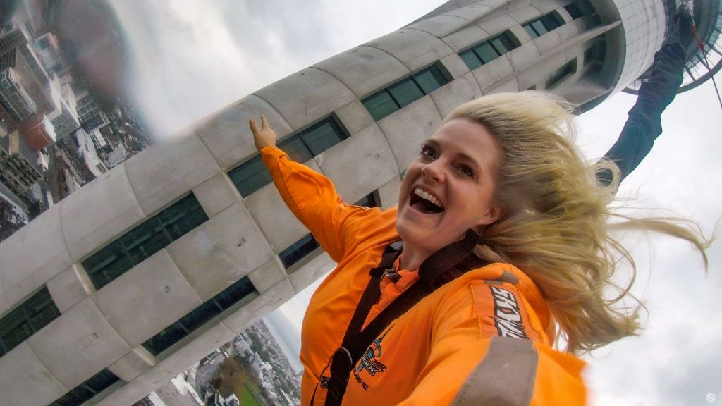 Leslie jumps from the Sky tower in New Zealand during their months there